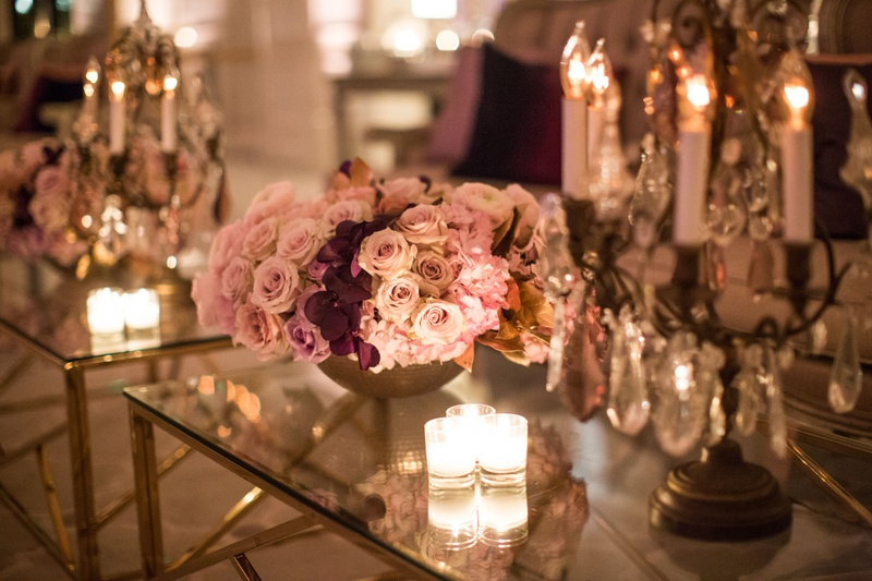 Wedding after party reception gold coffee table decorated with candle votives candelabra pink roses
