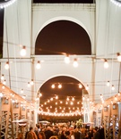 wedding reception at waco suspension bridge with lots of lights