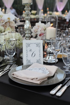 Black and white wedding table label with scroll design