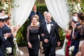 wedding ceremony parents mother in black dress and father in tuxedo bow tie