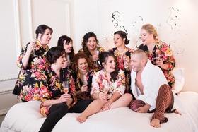 bridesmaids in black floral bridesmaid robes's bridesman