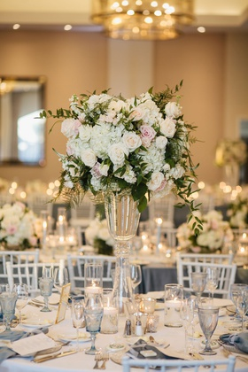 wedding reception hotel ballroom tall white hydrangea pink rose centerpiece blue glassware goblet