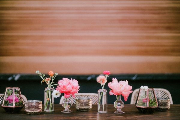 wedding reception decor wood background bar table with pink peony bud vases terrariums rattan chair