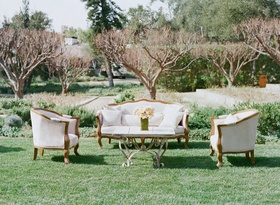 Wedding lawn San Ysidro Ranch cocktail hour lounge area with antique furniture rentals