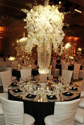 White flowers on top of crystal strand riser wedding centerpiece