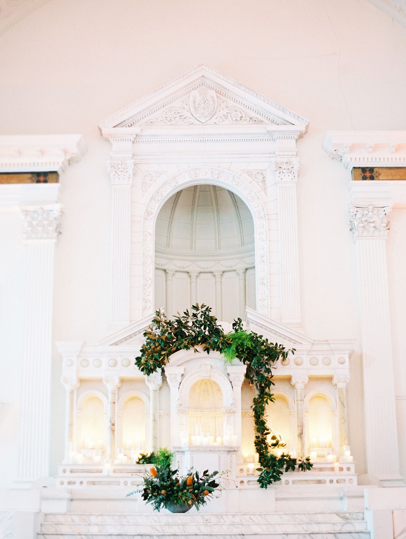 wedding venue vibiana white marble altar decorated with greenery vines pillar candles