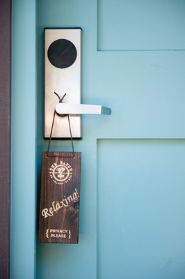 Wood door sign that asks for privacy at the groom's suite at The Ranch at Laguna Beach