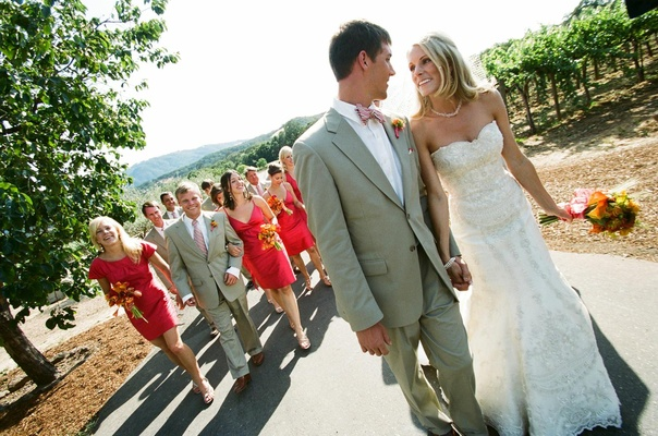 Couple with colorful bridesmaids and groomsmen