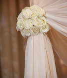 Ivory fabric chuppah with vanilla rose tieback for Jewish wedding