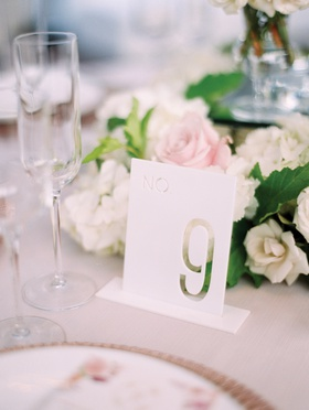 modern laser-cut table numbers at wedding reception