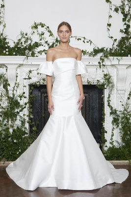 Monique Lhuillier Fall 2018 Mikado strapless trumpet gown with back bow detail and pleated arm cuffs