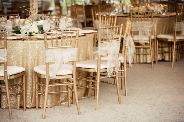 gold chivari chairs with sheer white bows, sequin gold linens