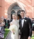 wedding ceremony recessional bride and groom outside of church flower petal toss high neck pronovias