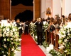 trumpeters black tuxedos announce bride with red carpet style aisle in church