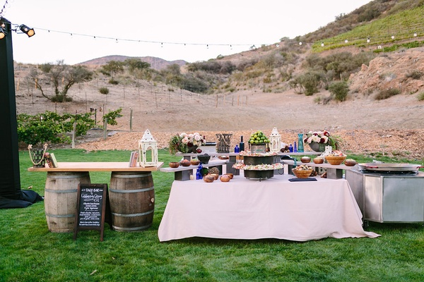 taco bar set up outdoors faux wedding party styled shoot rustic event farmhouse lawn barrels food