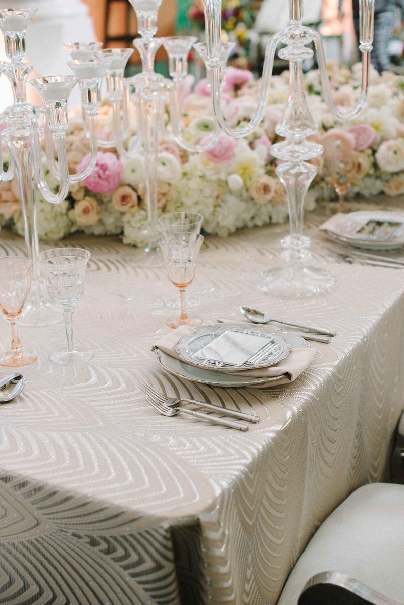 luxe linen cream cleopatra crystal candelabra peach glassware colored glassware & Reception Décor Photos - Soft Modern Table Setting - Inside Weddings