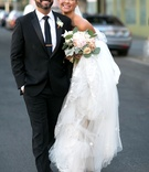Brittany Daniel actress on wedding day with bouquet and groom in suit and tie in downtown los angele