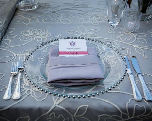 Wedding reception silver linens with flower details napkin with monogram menu card burgundy fall