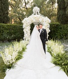 Bride in marchesa couture wedding dress groom in suit at beverly hills hotel wedding outdoor garden