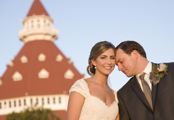 Bride and groom in front of Hotel del Coronado