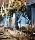 a floral table runner matching the blossoms incorporated into the hanging chandeliers