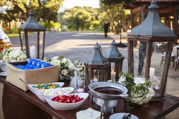 Ranch wedding reception with sundae table with wood and metal lanterns, LA Dogers cap bowls