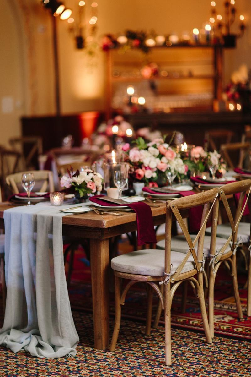 fall wedding inspiration velvet burgundy napkins peach white & pink flowers sheer grey table runner