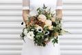 wedding bouquet white anemone red green verdure white flowers peach blooms berries