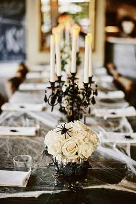 halloween wedding ideas long table cobwebs white rose spider black candelabra taper candles