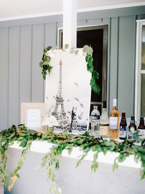 engagement party inspiration, paris proposal photo with greenery on bar