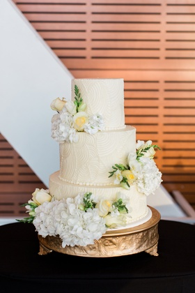 art deco relief inspired wedding cake pattern with fresh roses and hydrangeas