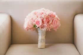 Bridal bouquet with light pink roses, ivory ribbon wrap and crystal bands