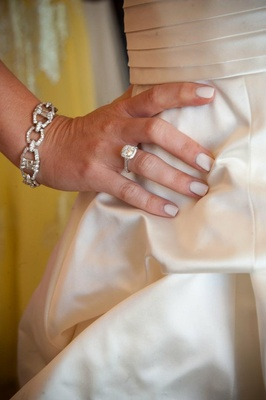 Bride with white manicure, engagement ring, and diamond bracelet