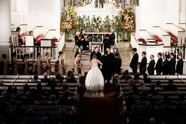 Bride and groom at ceremony altar in church