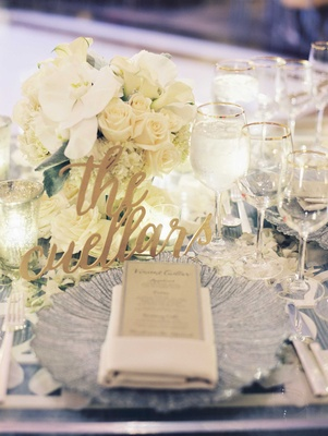 Sweetheart table with modern calligraphy laser cut sign with low centerpiece white orchid rose