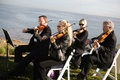 Oceanfront ceremony musicians in black
