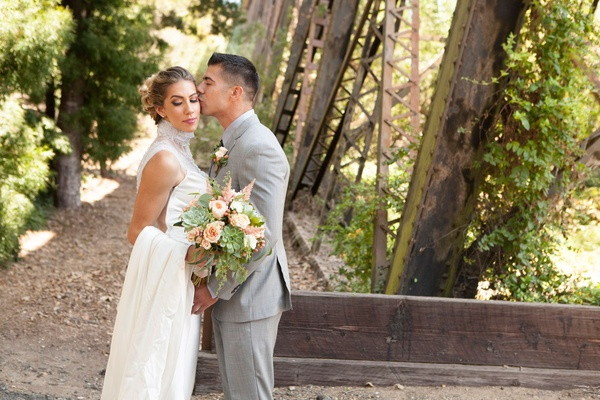 Bride in Ines Di Santo wedding dress from The White Dress high neck necklace over gown bouquet grey