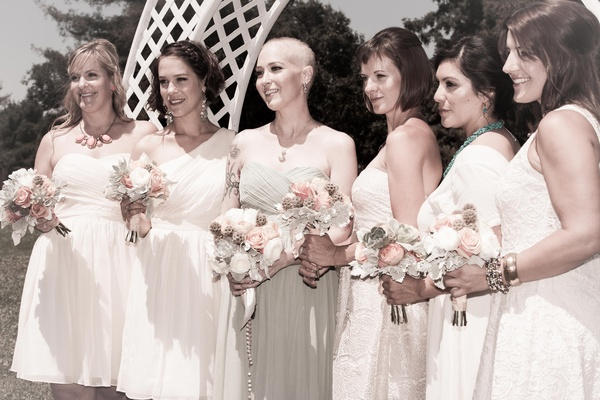 Bride with bridesmaids in short white dresses
