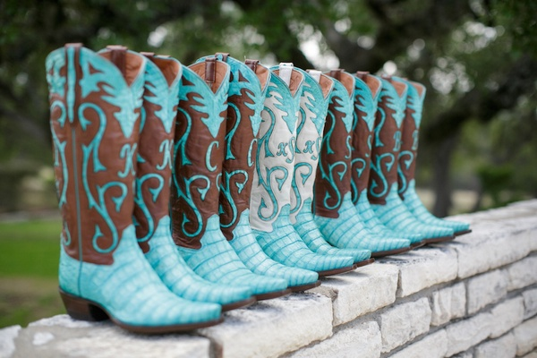 Brown and turquoise cowboy boots with bridesmaid initials for Texas ranch wedding