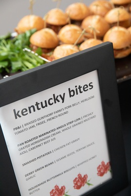 "frame of ""kentucky bites"" bridal shower menu with sliders in the background"