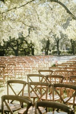 romantic wedding setting outdoor venue austin texas wood vineyard chair x back style trees
