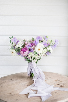 wedding bouquet pink white purple flowers with light purple ribbon trailing down