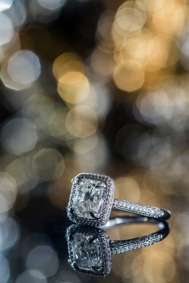 Cushion cut diamond with halo and pave diamond band engagement ring