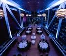 Clinton Library wedding venue reception purple lighting modern fixtures white tablecloths