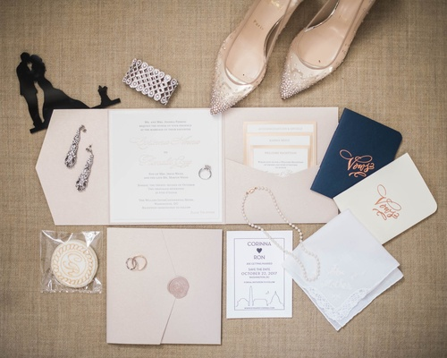 neutral hue invitation suite with vow books and wedding jewelry