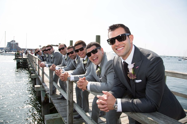 John Colaneri, co-host of Kitchen Cousins, in a dark grey suit and his groomsmen at pier