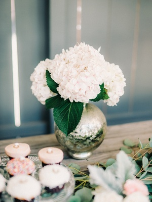 engagement party inspiration, round mercury vase with white hydrangeas and large green leaves
