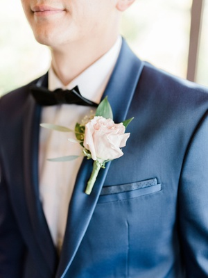 wedding boutonniere groom flower accessory bow tie navy blue suit jacket boutonniere