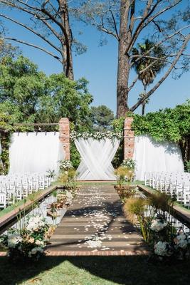 lily pond wedding ceremony venue white drapery greenery white chairs flowers santa barbara
