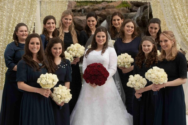 Navy bridesmaid dresses and rose bouquets